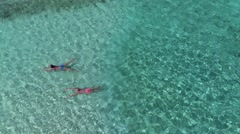 Aerial view of women swimming in the water at the beach, Lindquist beach, St Tho Stock Footage