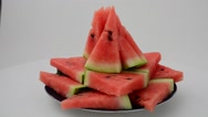 Shooting of a watermelon on a white background. Stock Footage