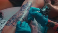 Close up of the Tattoo artist make tattoo at the studio Stock Footage