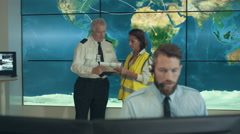 4K Security & surveillance team working in system control room Stock Footage