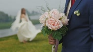 Bride dancing, the groom holds the wedding bouquet, slow-motion Stock Footage