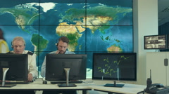 4K Time lapse security & surveillance team working in system control room Stock Footage