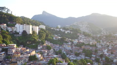 Aerial Rio de Janeiro, Santa Teresa hill with slums and Christ Statue in Brazil Stock Footage