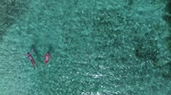 Aerial view of women floating in the water at the beach, Lindquist beach, St Tho Stock Footage