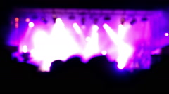Blurred scene of a rock concert. Purple lighting effects. Useful for backdrop. Stock Footage