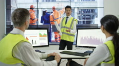 4K Workers in training session with manager in power station control room Stock Footage