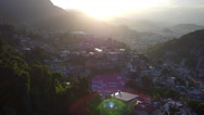 Aerial Rio de Janeiro, Santa Teresa hill with slums and sun rays in Brazil Stock Footage