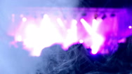 Blurred scene of a rock concert with spotlights. A blue smoke creates swirls. Stock Footage