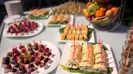 Catering. Decorated table, on skewers - grapes, brie cheese. Beautiful Sunny Stock Footage