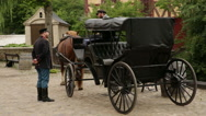 Shoot of horse carriage and extras dressed in classical dress and uniform..Sh Stock Footage