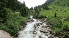 Hiking along the gerlos stream at Gerlostal valley at Zillertal area. Hight t Stock Footage