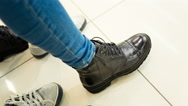Girl measures the new shoes Stock Footage