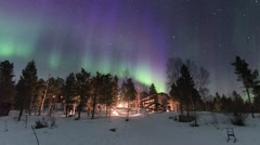 Norther lights green and violet over an iced lake in lapland Stock Footage