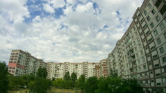 Clouds Moving Over The Multistorey Buildings. Time Lapse Stock Footage
