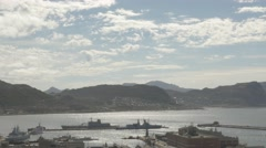 4k Ships at Naval Dockyard Pier Ocean Beach Mountains Stock Footage