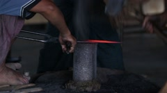 Blacksmith create a sword by forging molten metal hit by hammer with teamwork Stock Footage