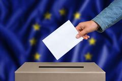Election in European Union. The hand of woman putting her vote in the ballot  Stock Photos