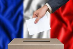 Election in France. The hand of man putting his vote in the ballot box. Frenc Stock Photos