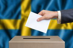 Election in Sweden. The hand of man putting his vote in the ballot box. Swedi Stock Photos