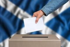 Election in Scotland. The hand of woman putting her vote in the ballot box. S Stock Photos