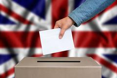 Election in United Kingdom. The hand of woman putting her vote in the ballot  Stock Photos