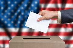 Presidential election in United States of America. The hand of man putting hi Stock Photos