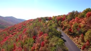Aerial shot of beautiful autumn fall colors and mountain road Stock Footage