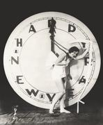 Woman pulling the hour hand of giant clock on New Year's Eve Stock Photos