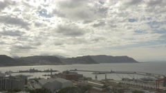 4k Wide Shot Naval Dockyard Pier Ocean Mountains In Background Cloudy Sky Stock Footage