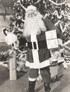 Santa Claus bearing gifts Stock Photos
