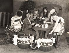 Young women offering an abundance of eggs to man Stock Photos
