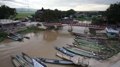 View at the Inle tourist boat port at Inle lake with boat moving pass Stock Footage
