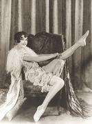 Flapper rolling up stockings Stock Photos