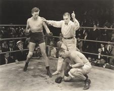 Referee counting over boxer in ring Stock Photos