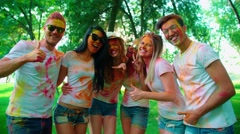 Company of young of different nationality friends having fun in the Park after Stock Footage