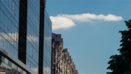 Mirrored and concrete building. Clouds. Stock Footage