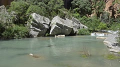 Mijares river. Zone in calm with waterfalls at the background Stock Footage
