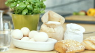 View of the kitchen table with a lot of ingredients on it, dolly shot Stock Footage