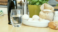 Woman using knife to mix eggs with flour on the wooden table, dolly shot Stock Footage