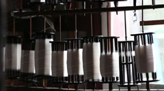 Weaving loom machines and spin yarn creating silk or cotton thread fiber Stock Footage