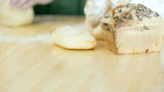 Female hands kneading the dough on the wooden table in the kitchen, dolly shot Stock Footage