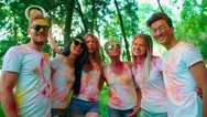 Cheerful company of young of different nationality friends having fun in the Stock Footage