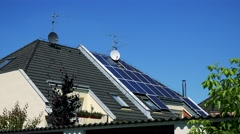 Modern family house - solar panels on the roof - sunny day  Stock Footage