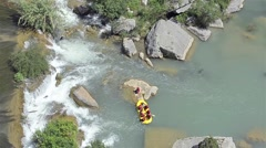 Small waterfalls, where people are doing rafting. Stock Footage