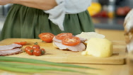 Woman adding basil to the freshly made sandwich in the kitchen, dolly shot Stock Footage