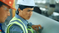 Workers measuring a tube with a tape measure. Industrial back ground with gas Stock Footage