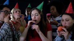 4K Nerdy friends having fun at house party & blowing up balloons Arkistovideo