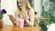 Girl browsing internet on tablet and laughing at something, steadycam shpt Stock Footage