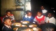 African American children at birthday party, 3630 vintage film family home movie Stock Footage