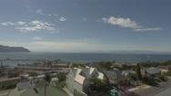 4k Wide Shot Naval Dockyard Pier Ocean Mountains In Background Cloudy Sky Stock Footage